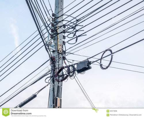 small resolution of mess electric and telephone cables on outdoor pole in bangkok