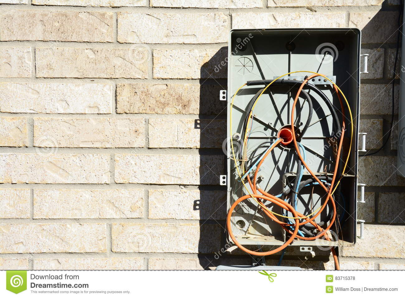 hight resolution of broken and messy cable television and internet wiring box with fiber optic cable