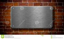 Metal Plate With Rivets Brick Background Stock