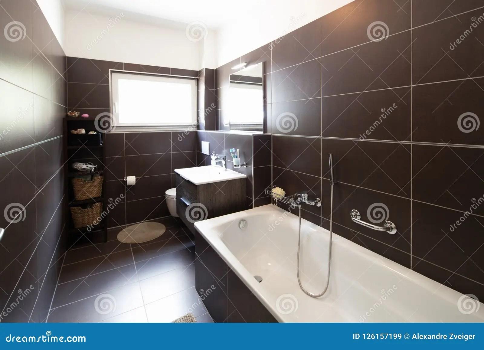 https www dreamstime com modern bathroom brown tiles window nobody insid bath wide modern bathroom brown tiles window image126157199