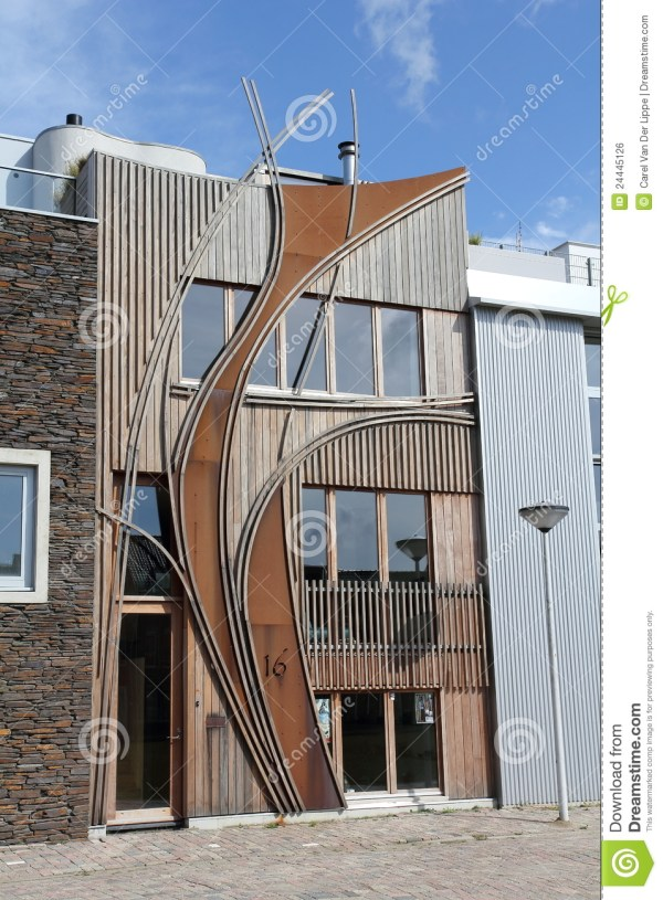 Modern Dutch Home With Wooden Curved Facade Stock