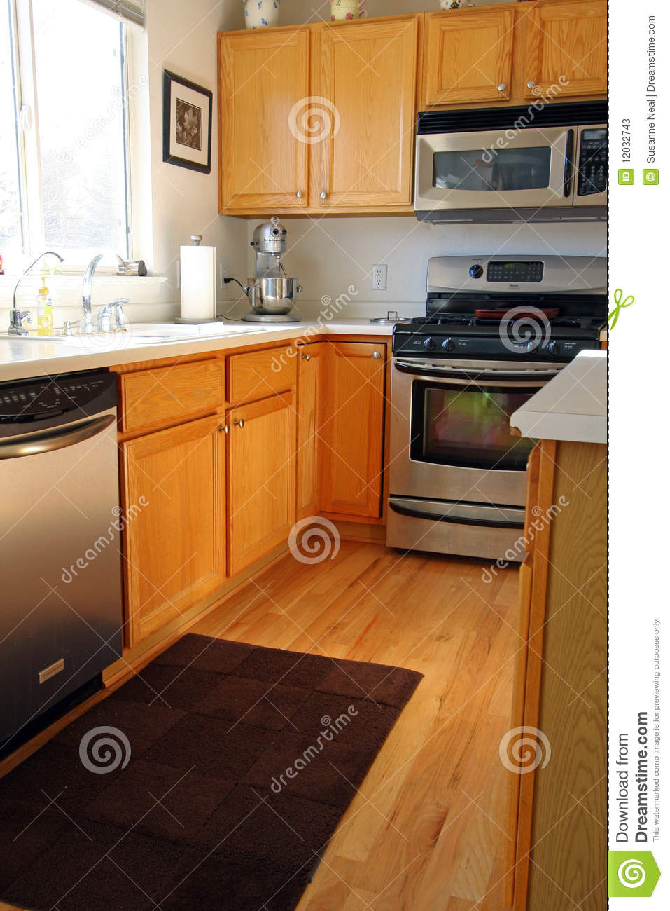 wood tile floor kitchen commercial refrigerator modern cabinets in oak stock photos - image: 12032743