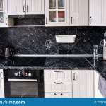 Modern Kitchen Is White With A Black Marble Countertop Stove Oven Cabinets And Sink With Tap Stock Image Image Of House Chair 198521283