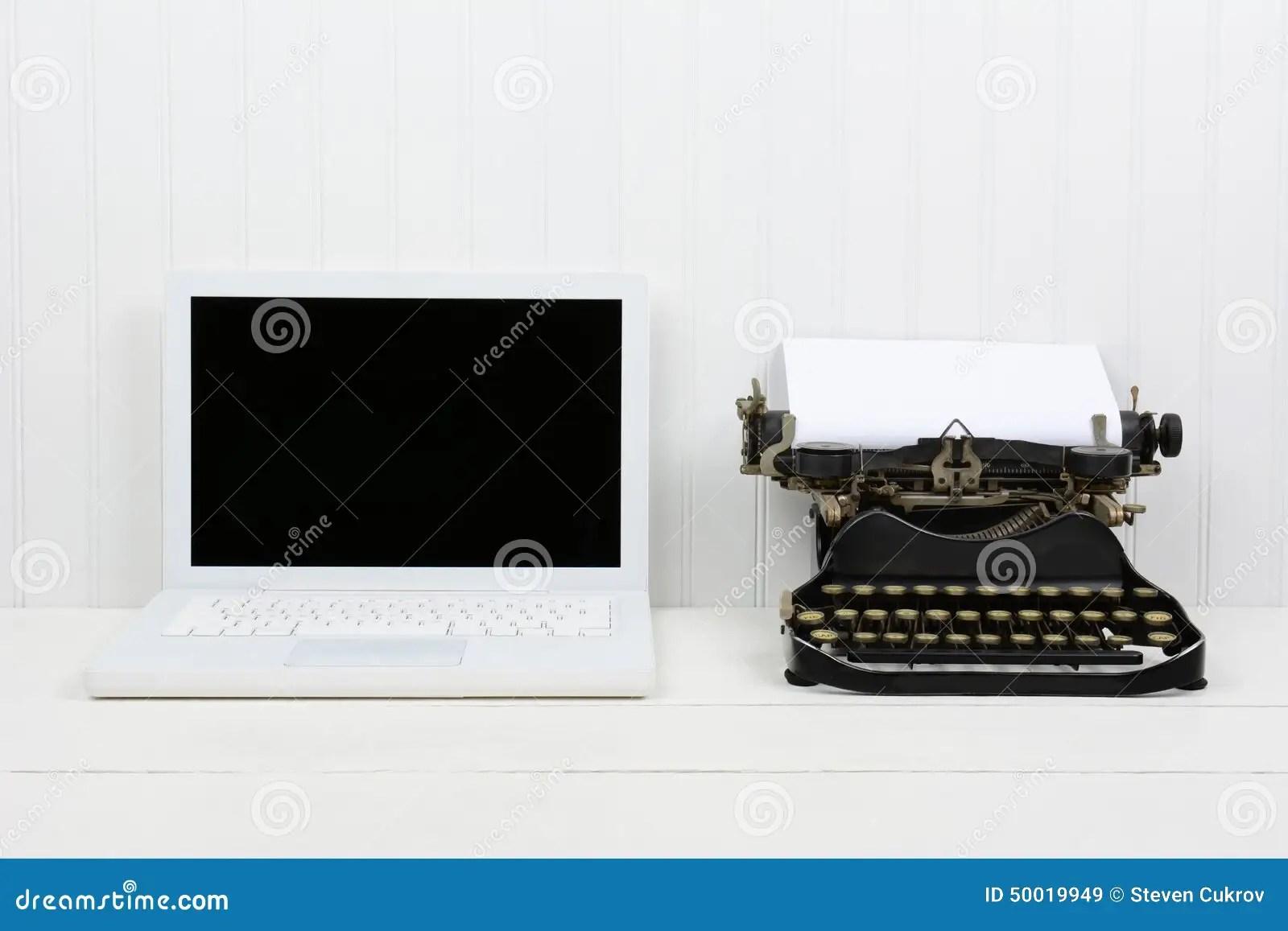 Modern Laptop And Antique Typewriter Stock Photo  Image