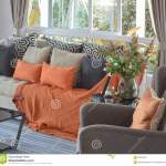 Modern Living Room With Brown And Orange Tweed Sofa Stock