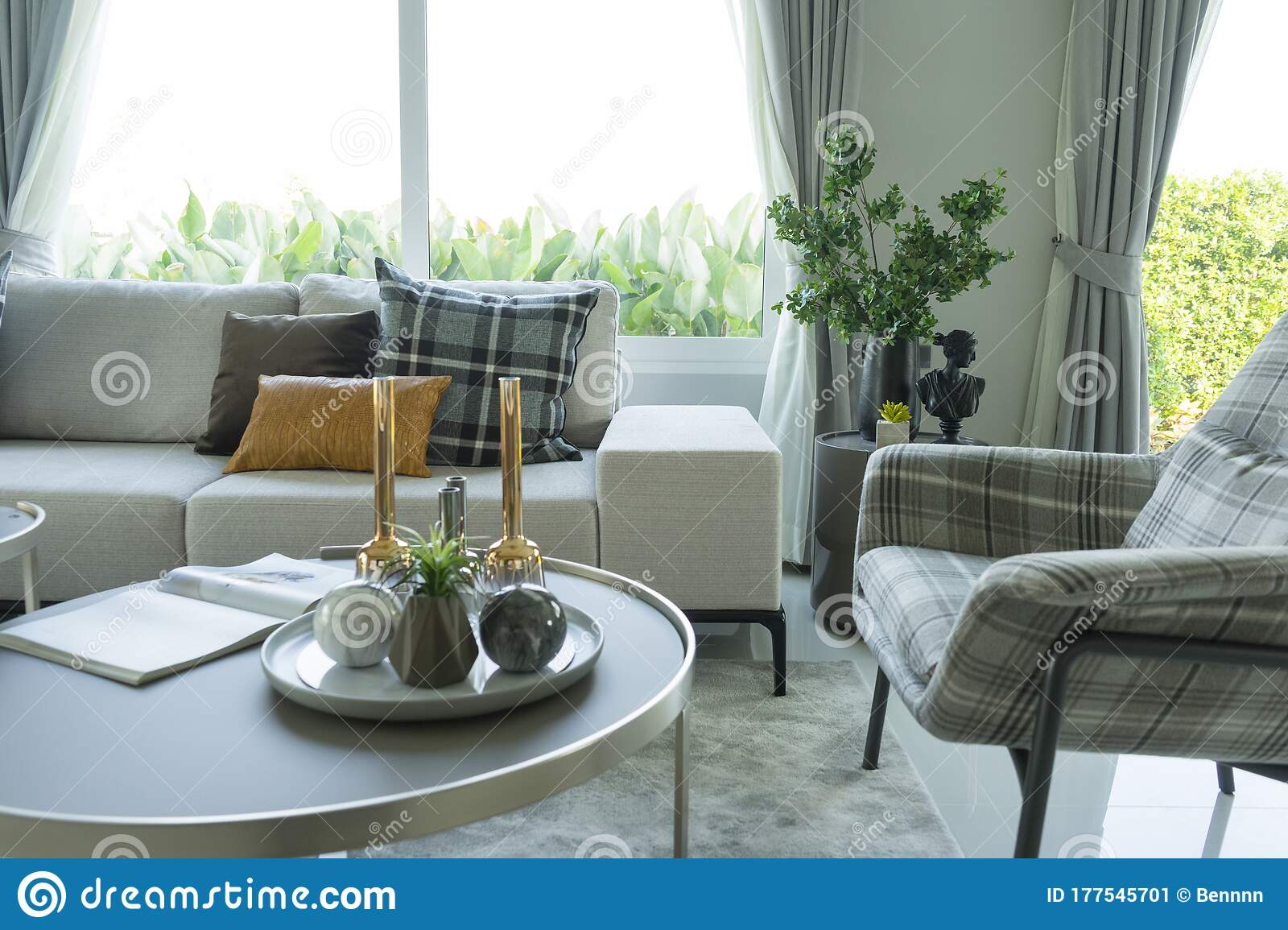modern living room with gray sofa coffee table and plaid pattern cushions by the big window stock image image of furniture contemporary 177545701