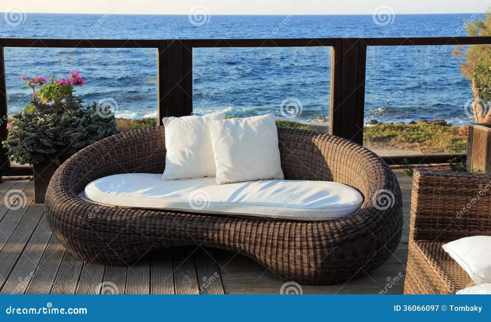 A Modern Wicker Garden Sofa Stock Image  Image of green