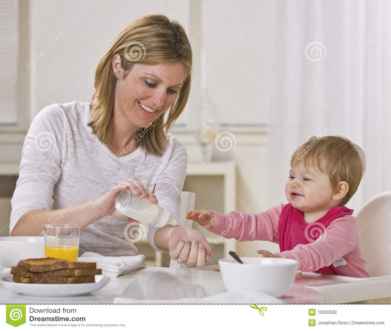baby table chair how to make a bean bag without sewing mom and eating breakfast stock photo - image: 10320582