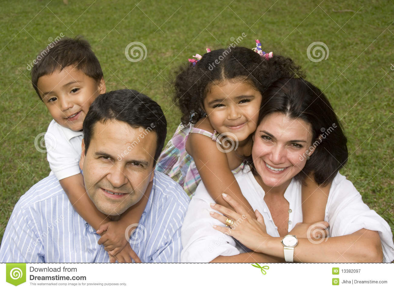 Mom And Dad Walking With Their Children Stock Image