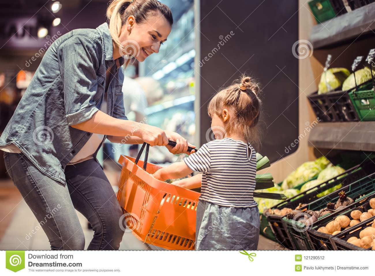 Mom And Daughter Are Shopping At The Supermarket Stock
