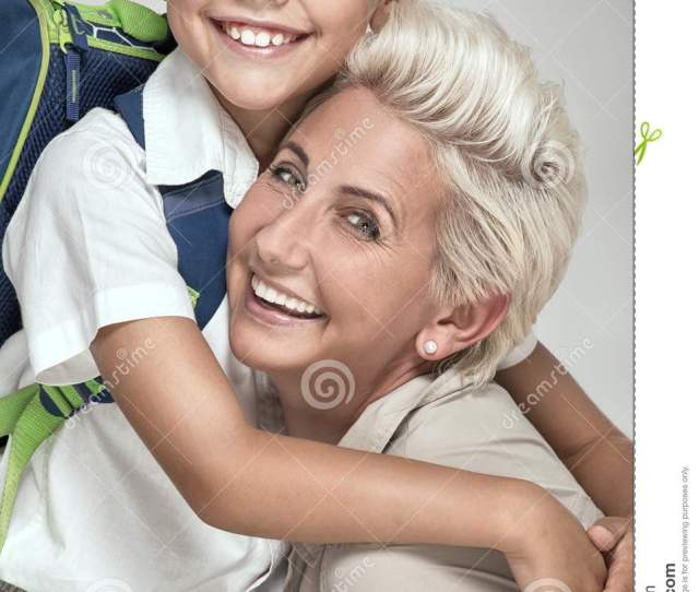 Mom With Young Son Posing Smiling To The Camera Boy With Backpack