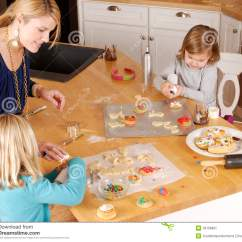 Country Rug For Living Room Built In Wall Units Rooms Mom And Two Daughters Cooking Cookies Stock Image - ...