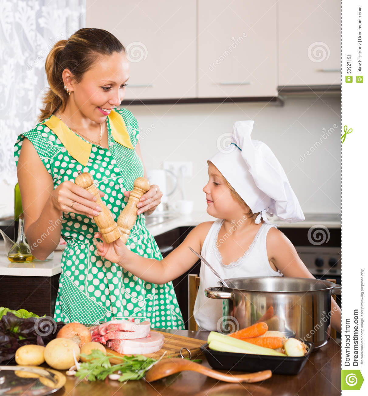 Mother With Baby Cooking At Kitchen Stock Image  Image of
