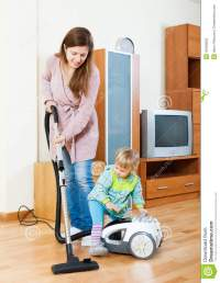 Mother With Child Cleaning Home Stock Photo