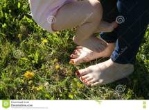 Mother And Child Walking Barefoot Grass Stock