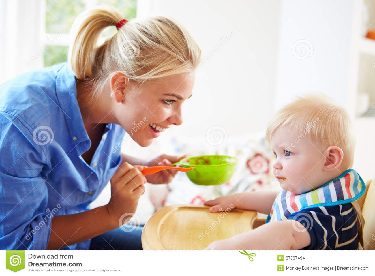 High Chair For Baby Boy Mother Feeding Baby Boy In High Chair Stock Images Image