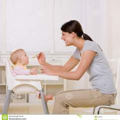 Baby High Chair For Eating Marcy Inversion Mother Feeding In Highchair Kitchen Stock Photo
