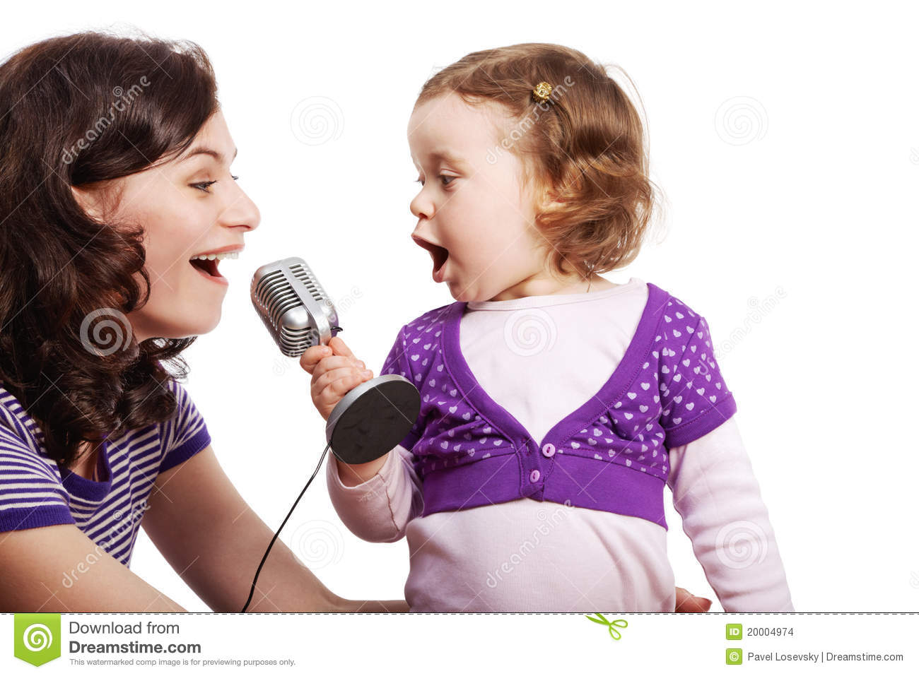 Mother And Her Daughter Sing Into Microphone Stock Photo