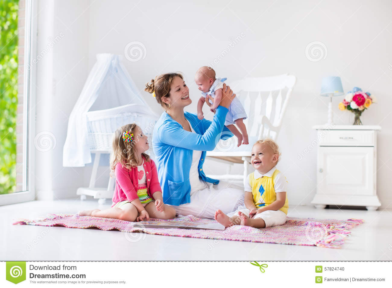 white indoor rocking chair zeus thunder ultimate gaming systems mother and kids playing in bedroom stock photo - image: 57824740