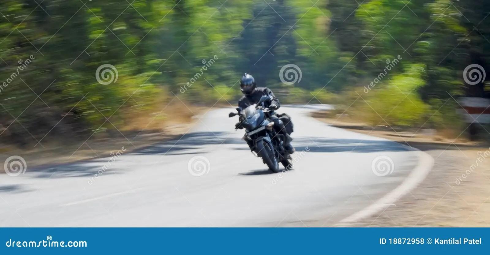 Motorbiker Speeds On Mumbai Goa Road Royalty Free Stock