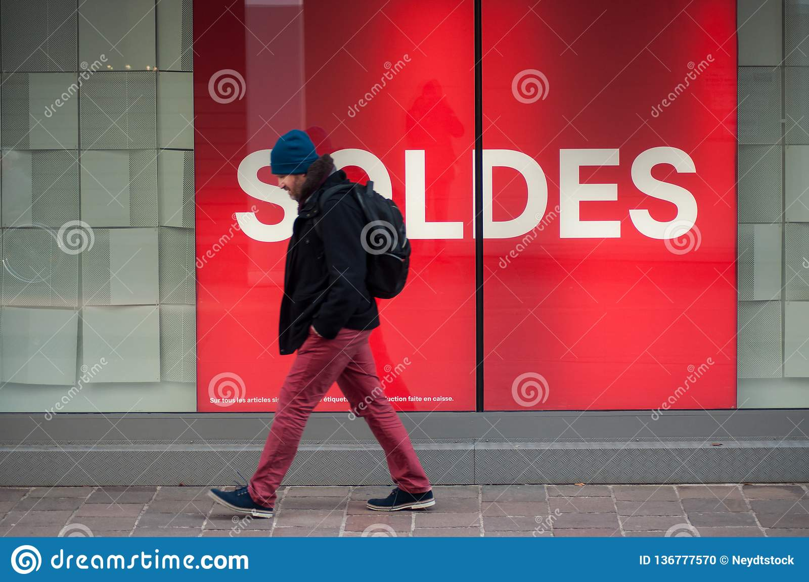 https www dreamstime com mulhouse france january portrait man walking street front fashion store text french soldes traduction english sales image136777570
