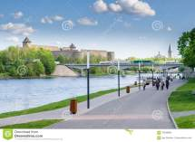 Narva River Embankment With Vacationers People And
