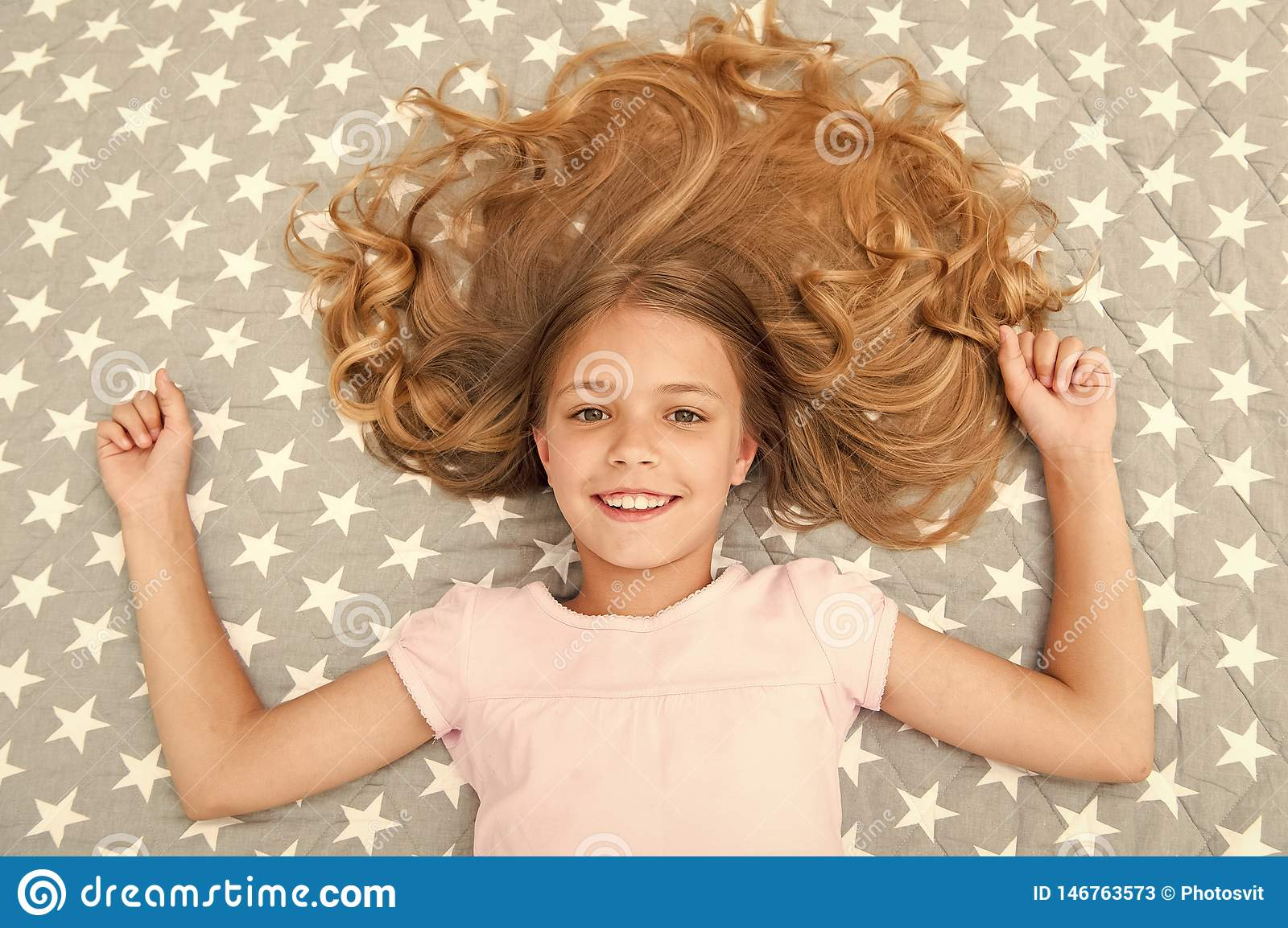 Natural Curls Treat And Care Girl Child With Long Curly Hair Lay