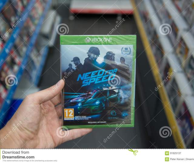 Bratislava Slovakia Circa April 2017 Man Holding Need For Speed Videogame On Microsoft Xbox One Console In Store