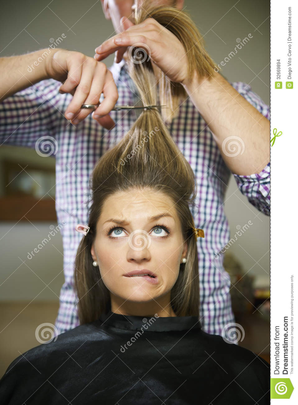 Nervous Woman In Hairdresser Shop Cutting Long Hair Stock