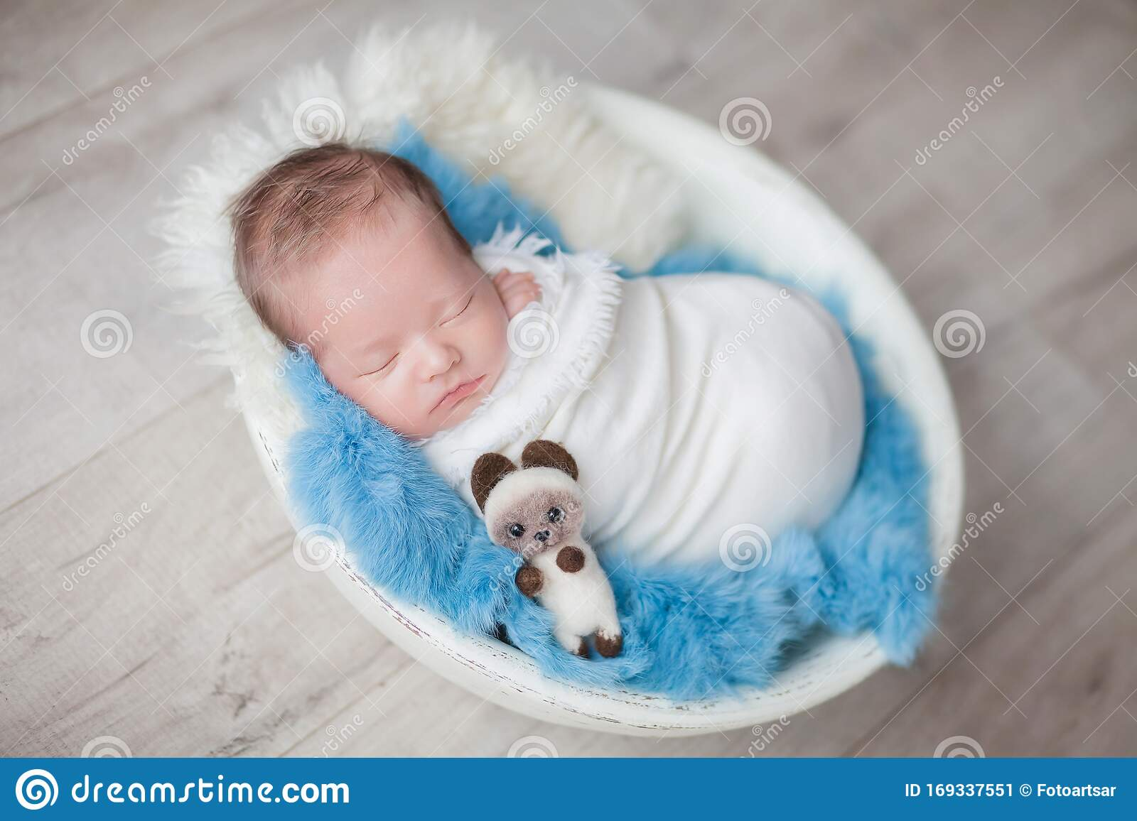 Newborn Baby Boy In A Cocoon In A White Bowl On A Blue Rug Stock Image Image Of Sweet Newborn 169337551