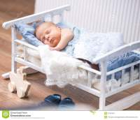 Newborn Baby In A Small Bed Royalty Free Stock Photography ...