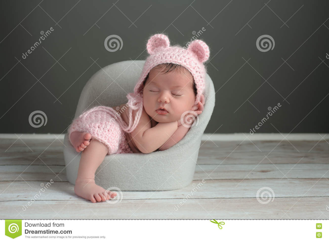 baby sleeping chair ripple black leather office newborn girl wearing a pink bear hat stock photo image