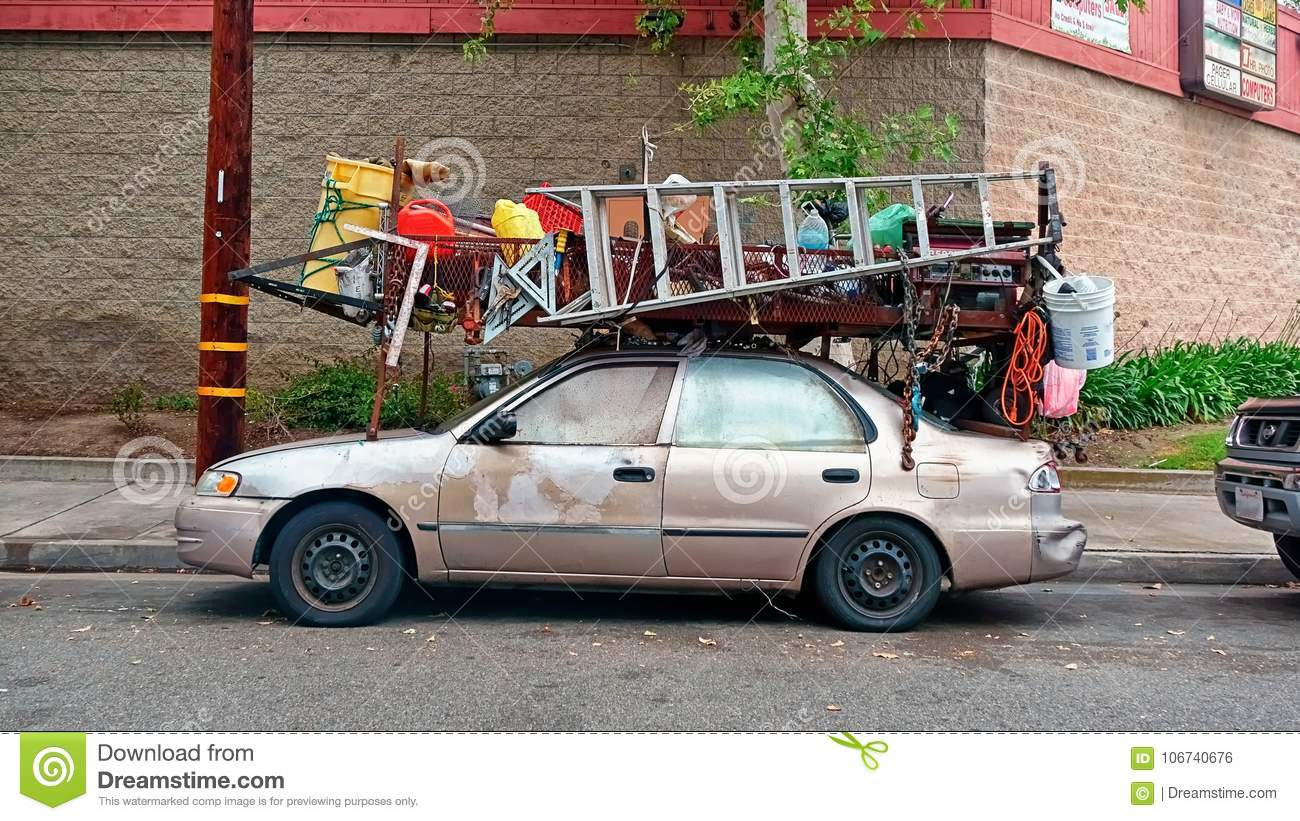 https www dreamstime com now s handyman dude who put lumber rack his little sedan strapped all his tools equipment to steel image106740676