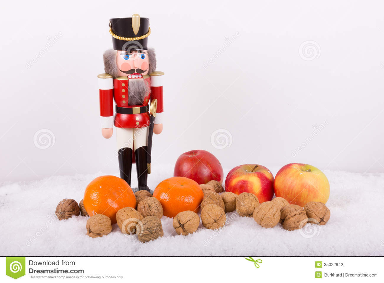 Nutcracker With Nuts Tangerines At Christmas Time Stock