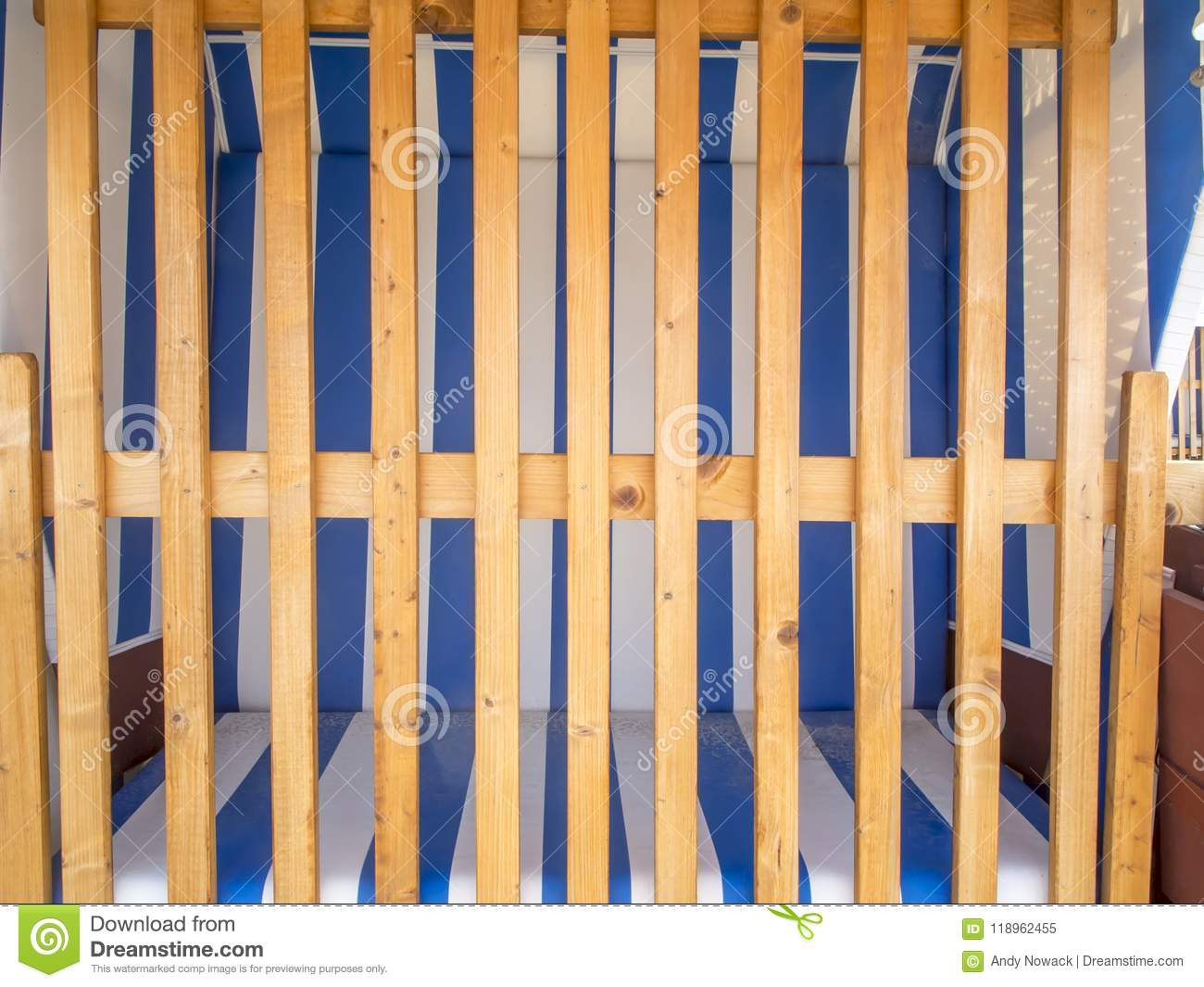 wooden frame beach chairs meco folding obstructed chair with barricade stock image of frontal view on a locked
