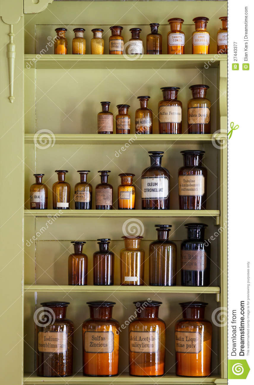 Old Apothecary Cabinet With Storage Jars Royalty Free