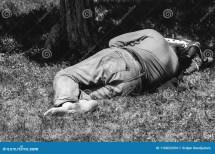 Barefoot Homeless Refugee Man Sleeping Grass