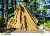 Old Canvas Tent Stands In A Pine Forest On The Island ...