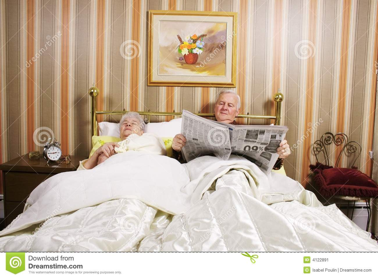 Old Couple In Bed Stock Image