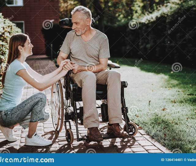 Old Man And Young Woman Walk Elderly And Girl
