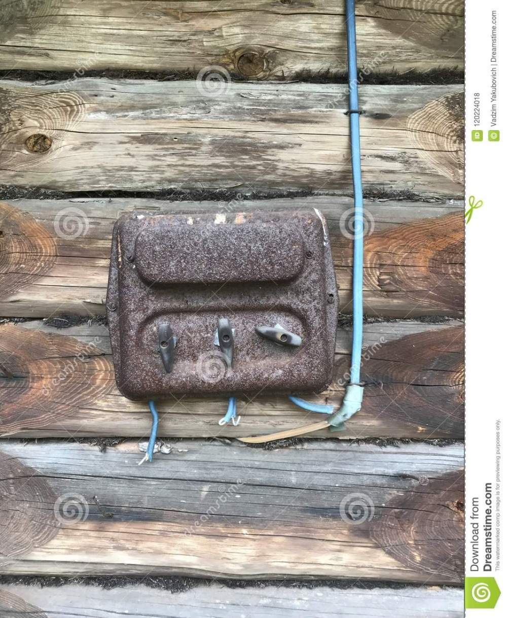 medium resolution of an old rust covered electric flap on the wall of a wooden shed electrical