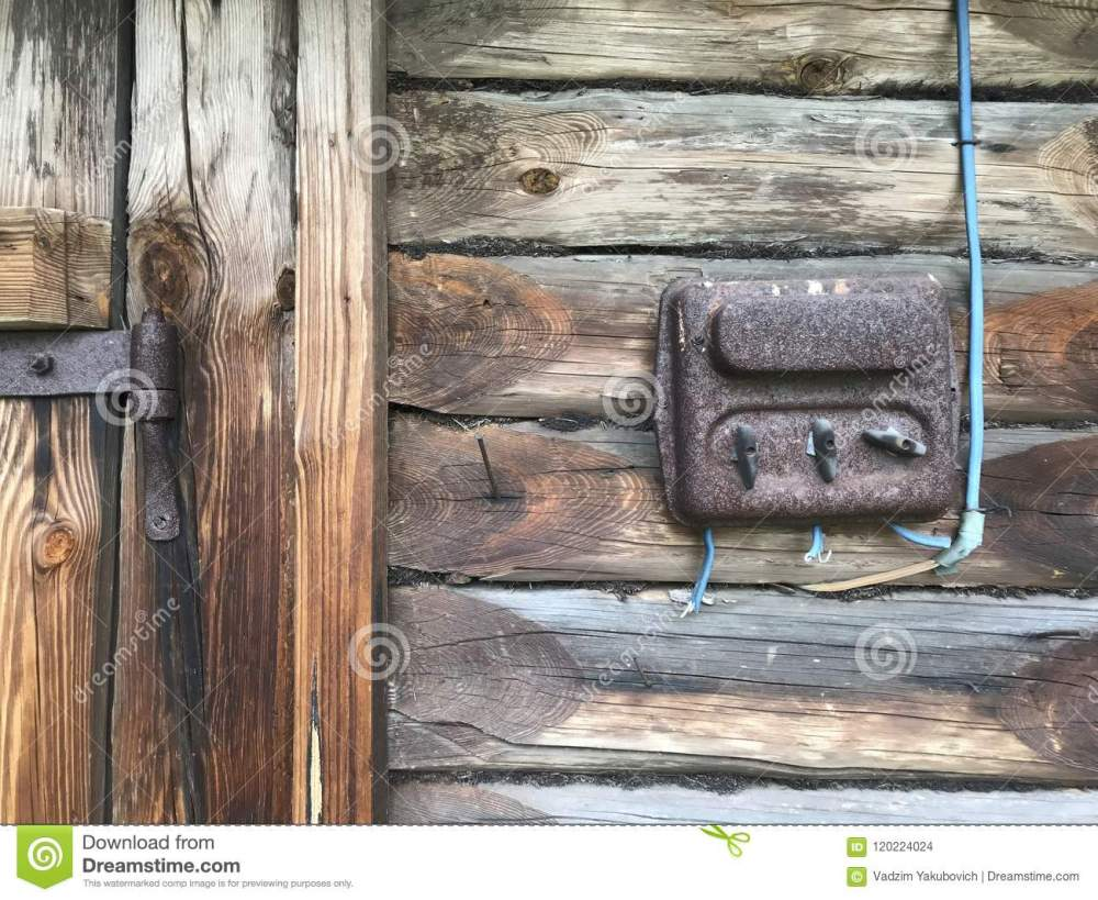 medium resolution of an old rust covered electric flap on the wall of a wooden shed electrical wiring and plastic switches are visible