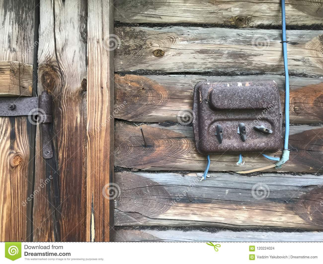 hight resolution of an old rust covered electric flap on the wall of a wooden shed electrical wiring and plastic switches are visible