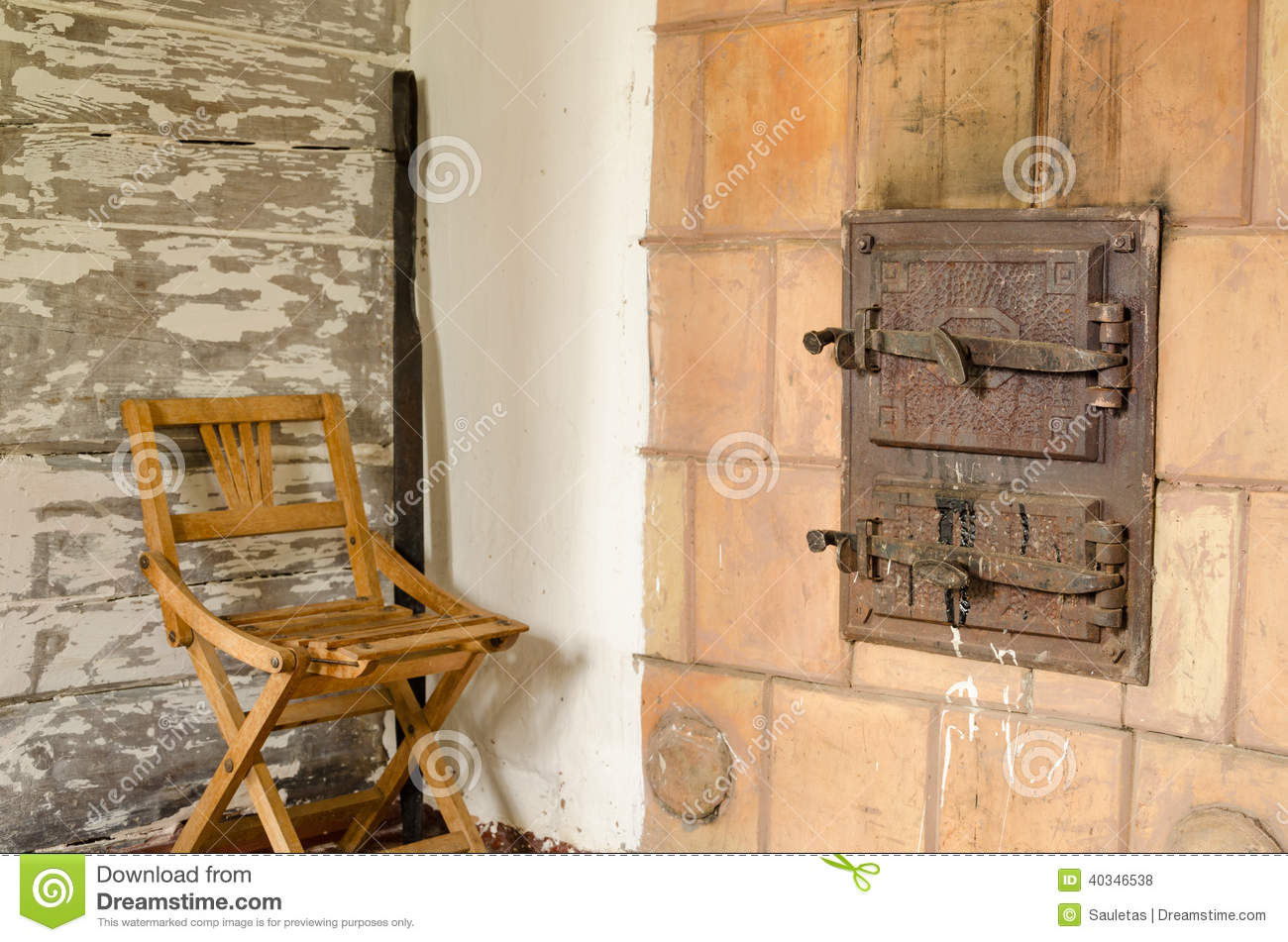 Old Rustic Furnace Doors And Wooden Rest Chair Stock Photo