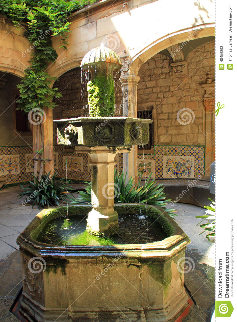Old Stone Water Fountain In Church Courtyard In Barcelona