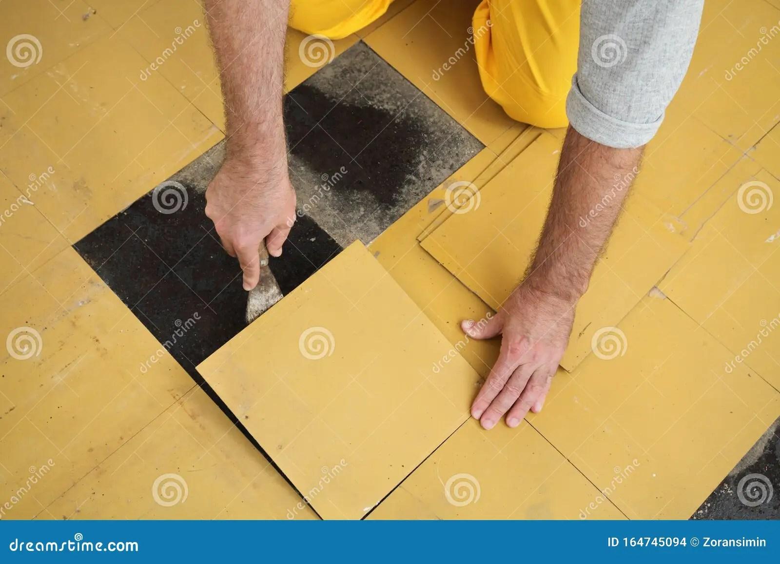 https www dreamstime com old vinyl tiles removal floor room kitchen worker removing old vinyl tiles kitchen floor using spatula trowel image164745094