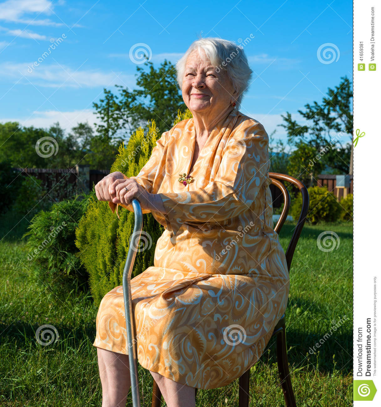 old lady chair very unusual chairs woman sitting on a with cane stock photo