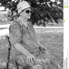 Old Lady Chair Yugoslavian Folding Woman Sitting On A Royalty Free Stock Images