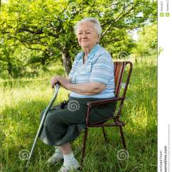 Old Lady Chair All Weather Outdoor Patio Chairs Woman Sitting On A Stock Image Of Adult