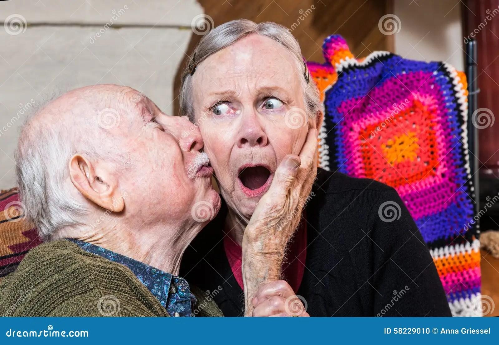 Older Gentleman Kissing Older Woman On Cheek Stock Photo